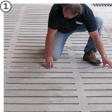 slatted floor is measured for producing tailor-made slatted floor coverins made of rubber