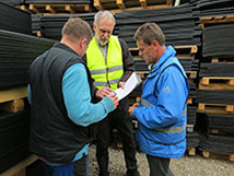 Dr. Reubold – test engineer of the DLG – (middle) randomly selects one mat in our storage