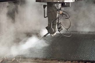 New technology high pressure water jet cutting of rubger mats at KRAIBURG